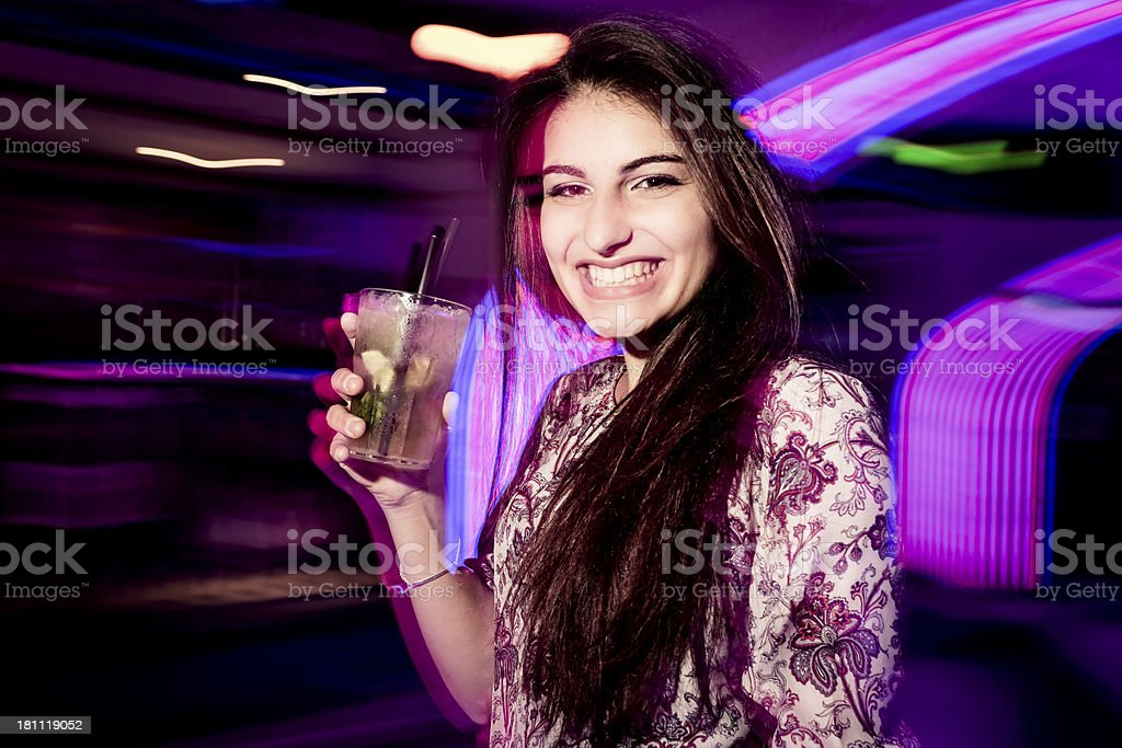 Young girl dancing in the nightclub. royalty-free stock photo