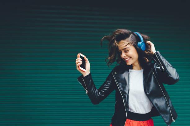 young girl dancing to the music - music foto e immagini stock