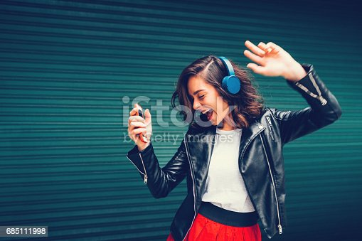 istock Young girl dancing to the music 685111998