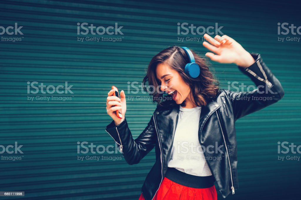 Young Girl Dancing To The Music Stock Photo