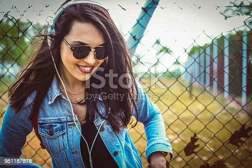 istock Young girl dancing to the music 951187878