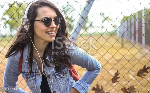istock Young girl dancing to the music 951187996