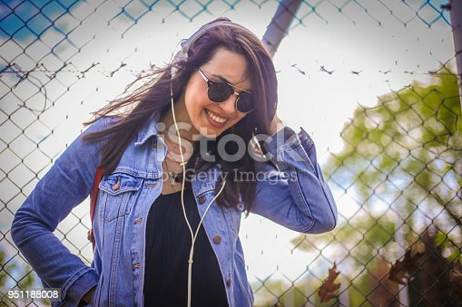 istock Young girl dancing to the music 951188008