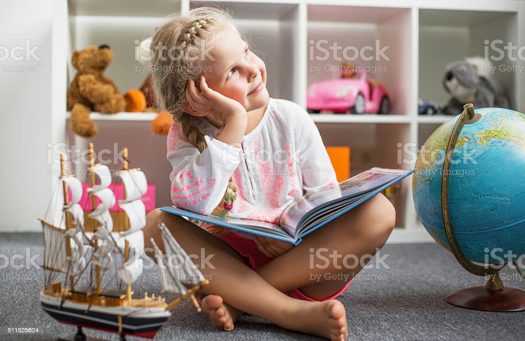 Young girl daydreaming stock photo
