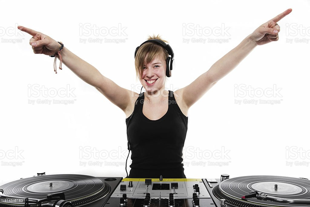 Young girl DJ posing at the turntables royalty-free stock photo