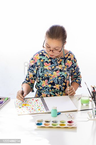172382347 istock photo Young Girl Doing Art Class 1222486214