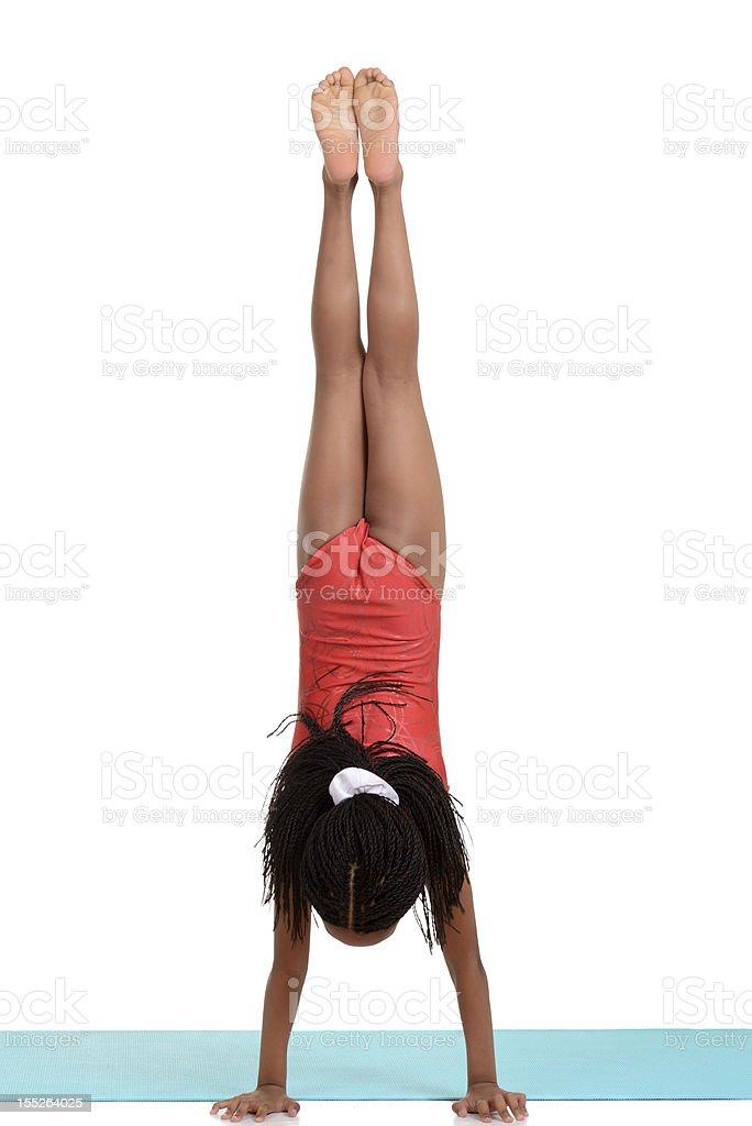 young girl doing gymnastics handstand stock photo