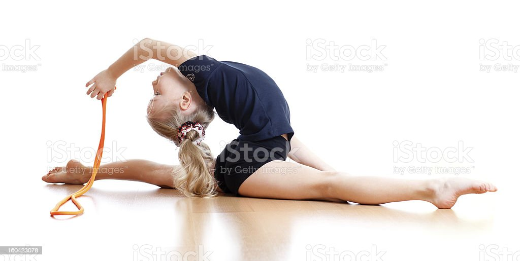 young girl doing gymnastics over white background royalty-free stock photo