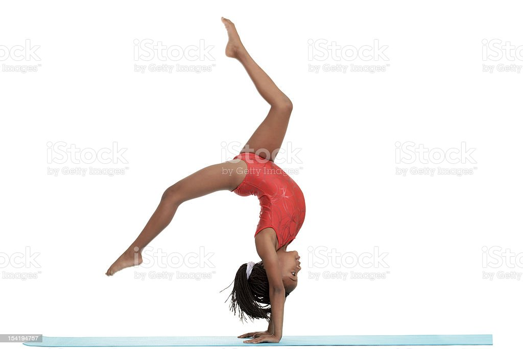 young girl doing gymnastics with motion blur stock photo