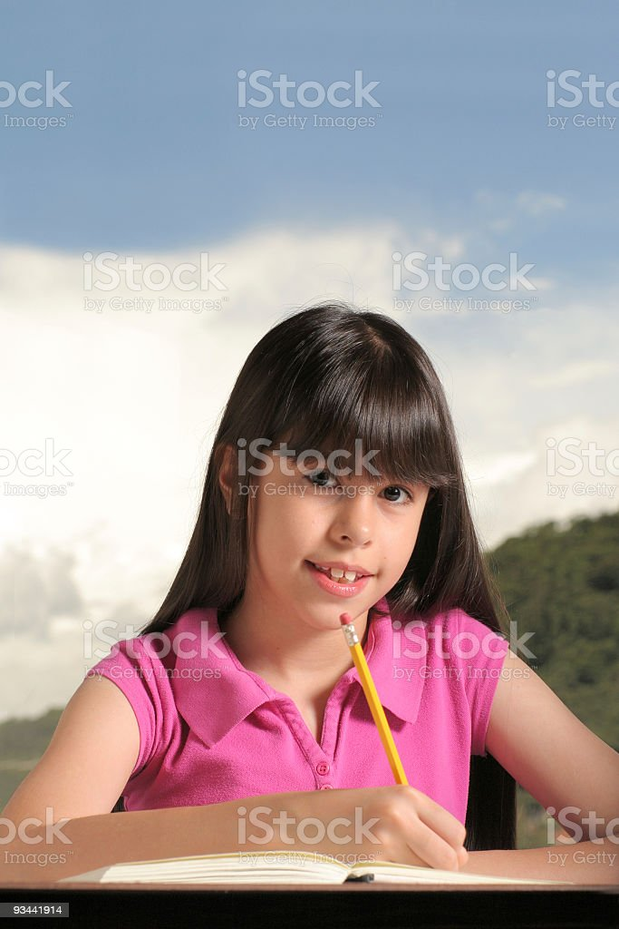 Young Girl Doing Her Homework Outside royalty-free stock photo