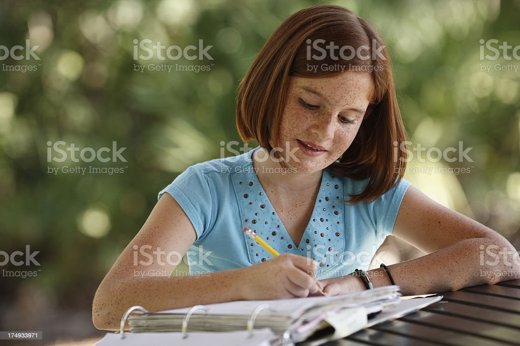 Young girl doing homework royalty-free stock photo