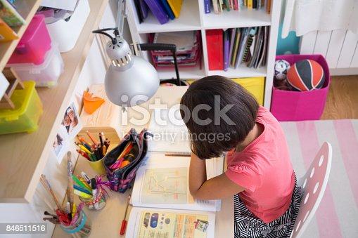 istock Young girl doing homework 846511516