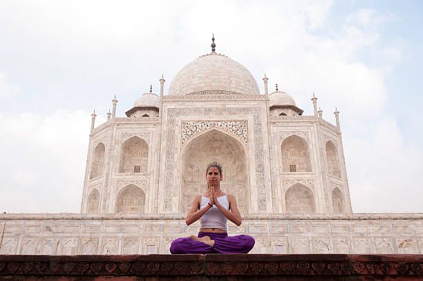 young girl doing meditation at taj mahal - mahroch stock pictures, royalty-free photos & images