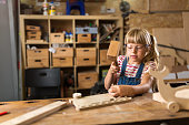 Young girl doing woodwork in a workshop