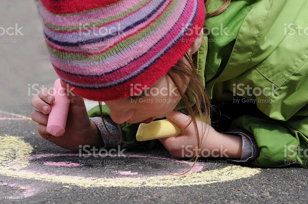 Young girl drawing with chalk royalty-free stock photo