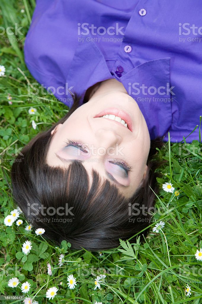 Young girl dreaming in daisy field royalty-free stock photo
