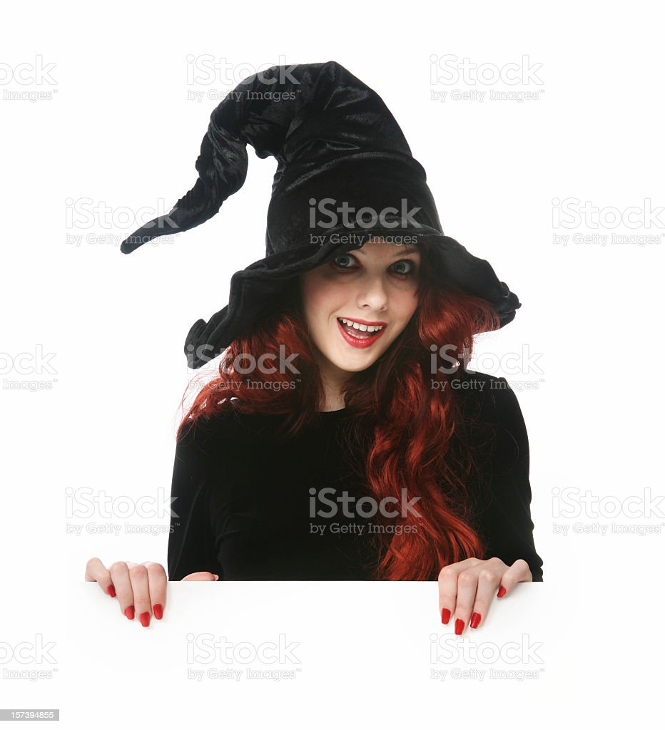 Young girl dressed as a witch isolated on white  royalty-free stock photo