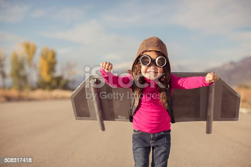 istock Young girl dressed as pilot wearing jet pack 508317418
