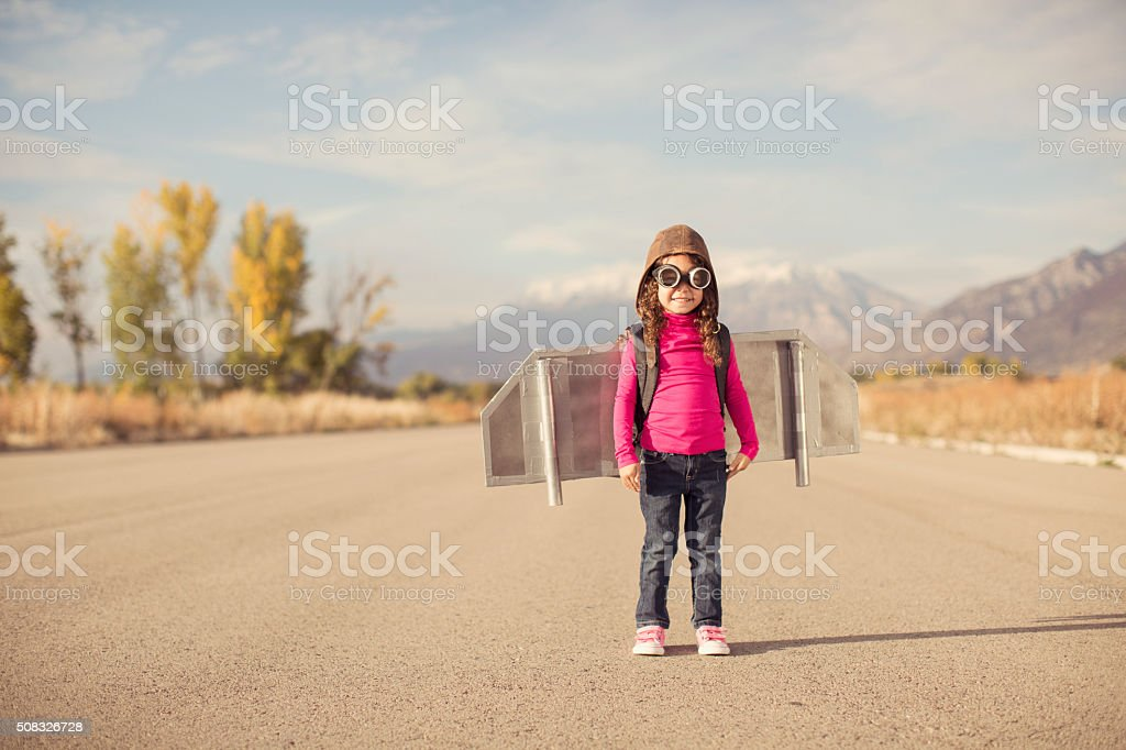 Young girl dressed as pilot wearing jet pack stock photo