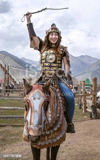 Lake Issyk-Kul, Kyrgyzstan, 6th September 2018: girl in mongol warrior outfit during World NOmad Games 2018