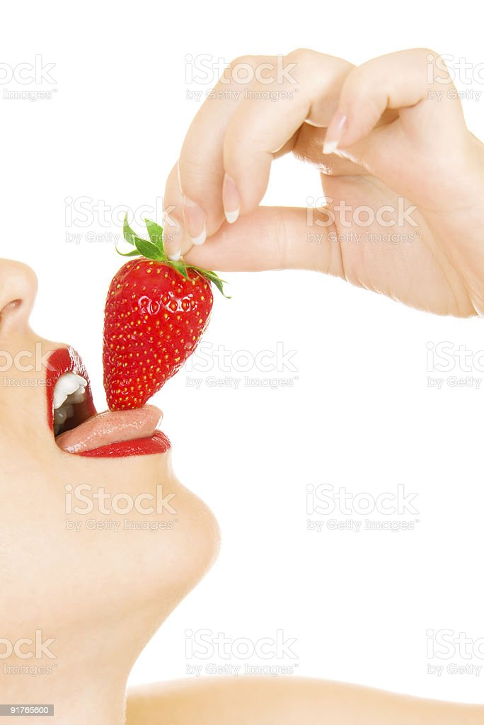 Young girl eat strawberry royalty-free stock photo