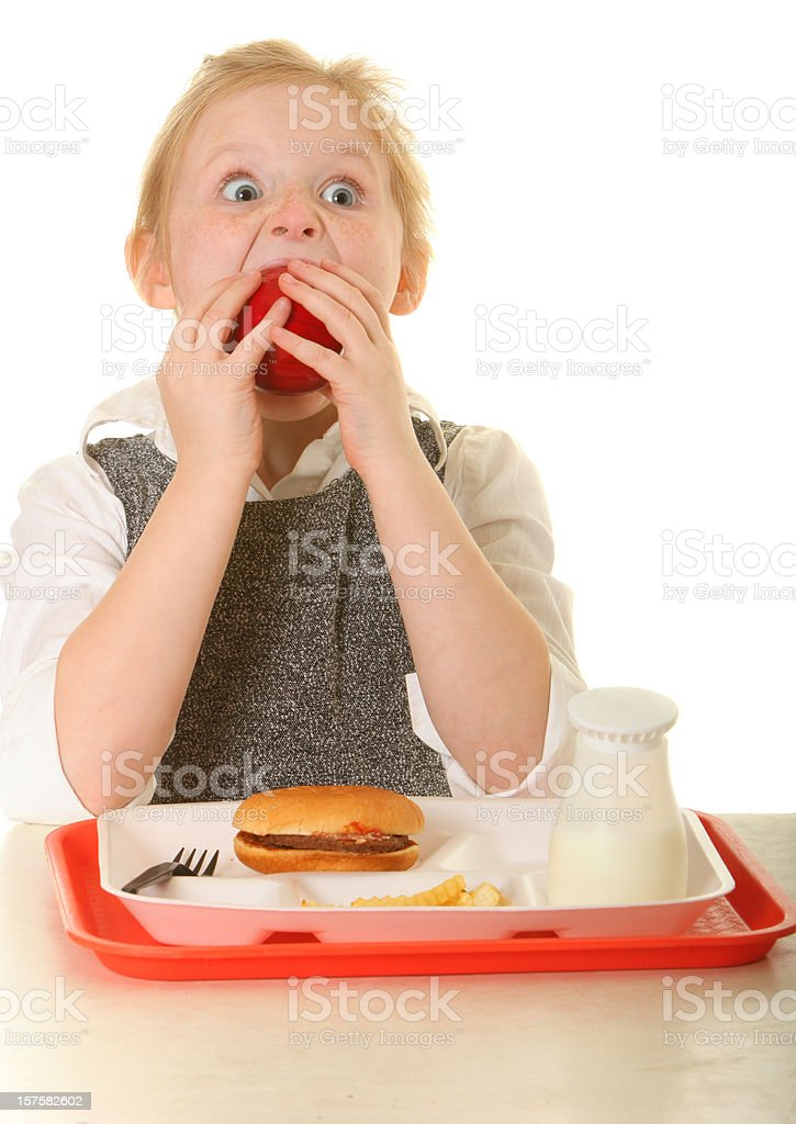 young girl eating an apple royalty-free stock photo