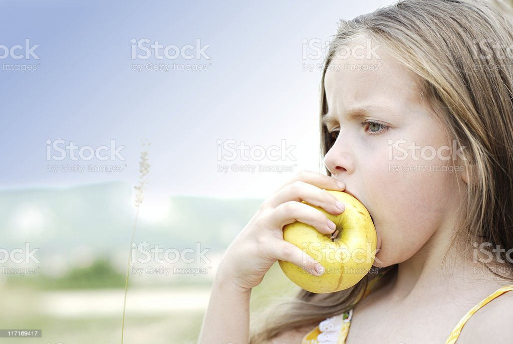 Young girl eating apple royalty-free stock photo