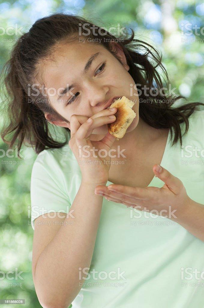 Young Girl Eating Bannock and Honey stock photo