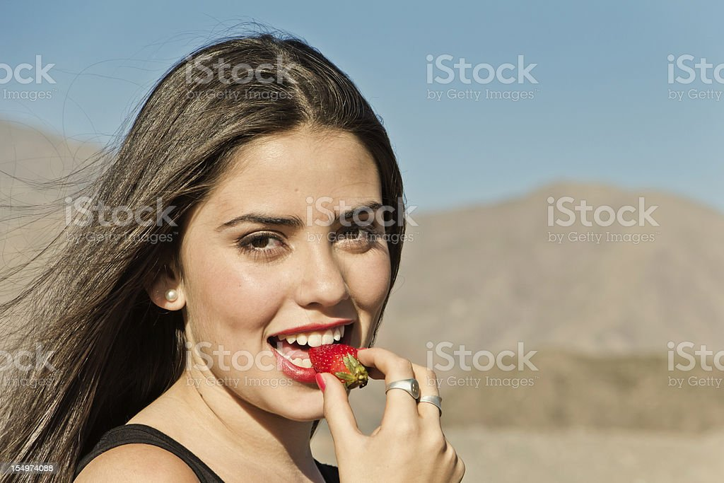 Young girl eating strawberry royalty-free stock photo