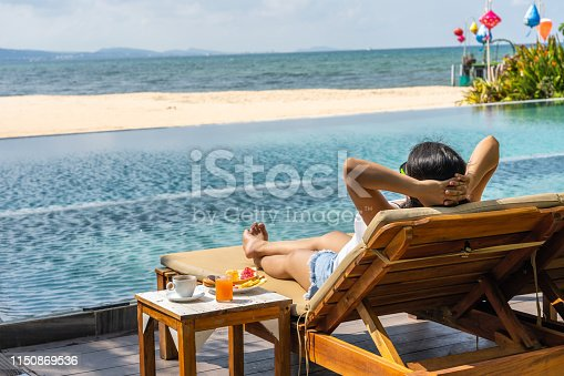 Young girl enjoy summer vacation on the luxury resort