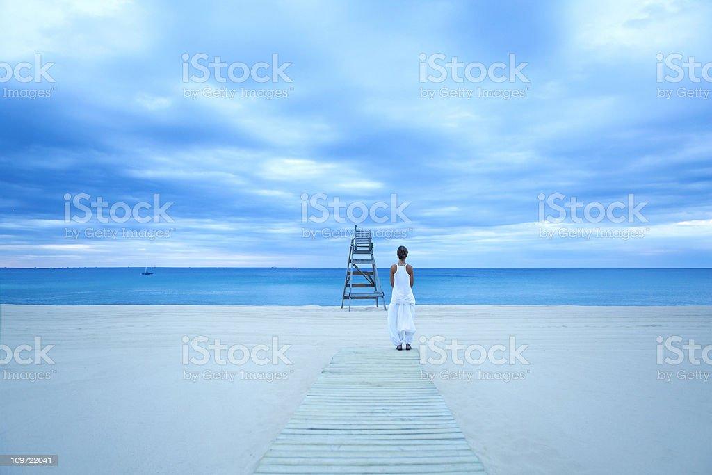 Young girl enjoying the sea royalty-free stock photo