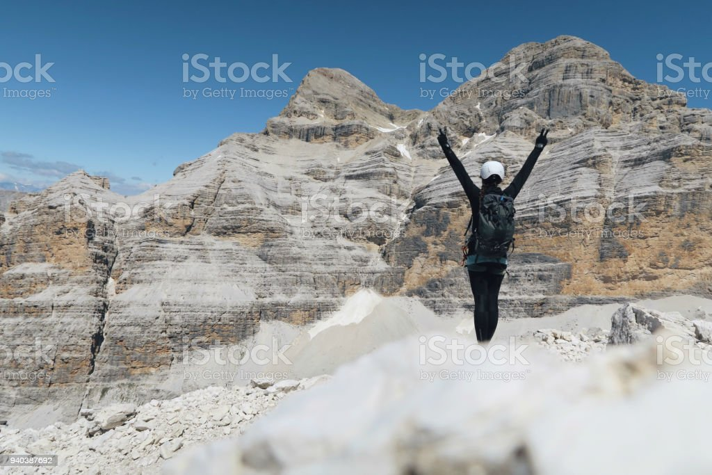 Young girl enjoying the view / via ferrata stock photo