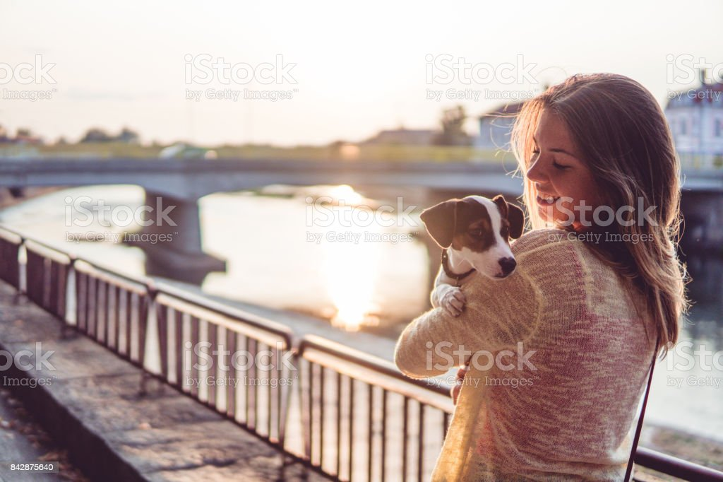 Young girl enjoying time with her dog stock photo