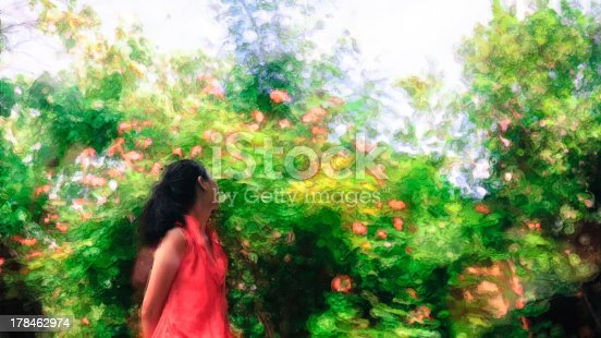 172214590 istock photo young girl enjoys herself looking at flowers and trees 178462974