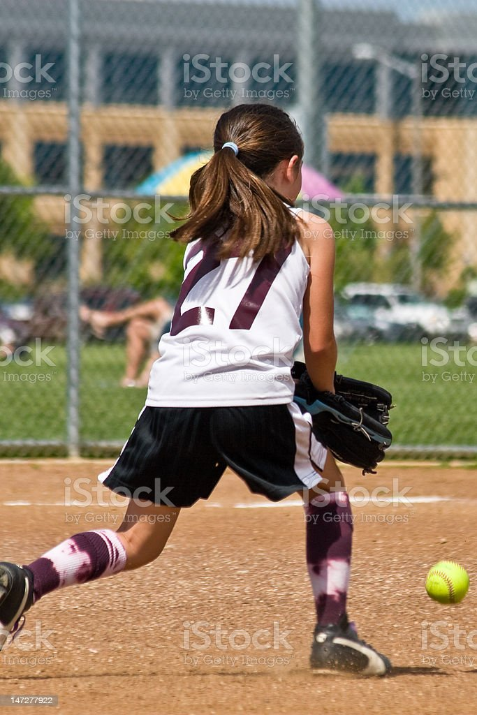 Young Girl Fielding Softball royalty-free stock photo