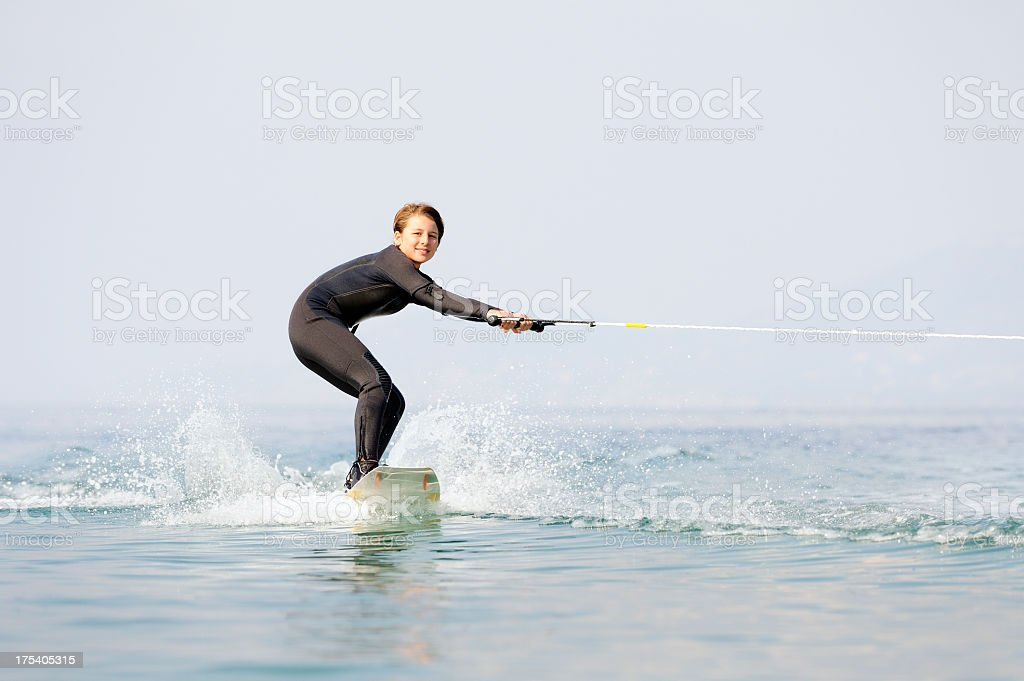 Young Girl First Time Wakeboarding royalty-free stock photo