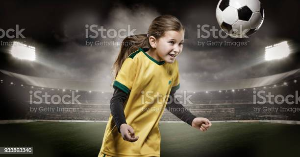 Young girl football player heading a soccer ball in a floodlit picture id933863340?b=1&k=6&m=933863340&s=612x612&h=1n8es52q7 kym0ymahxuaiuyion2rbfz8d5zxr8m584=
