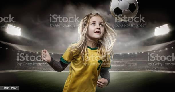 Young girl football player heading a soccer ball in a floodlit picture id933865626?b=1&k=6&m=933865626&s=612x612&h=bbhtsp5ll2ixkfrqriybowms6jxgtowvyztmgcrtqwg=