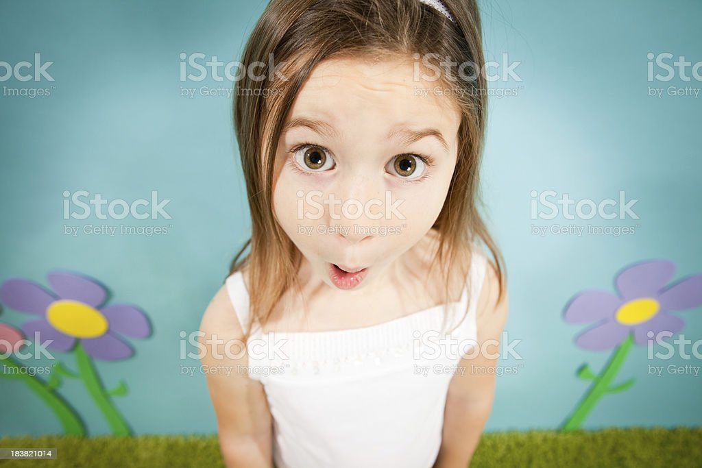 Young Girl Gasping with Surprise in Whimsical World stock photo