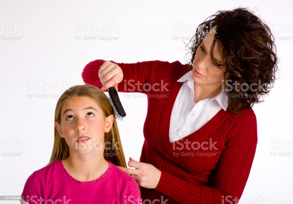 Young Girl Getting Hair Brushed royalty-free stock photo