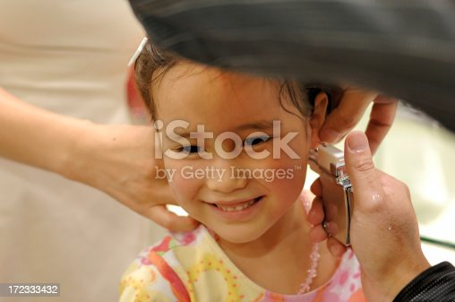 She really wanted to have her ears pierced - and follow her older sister