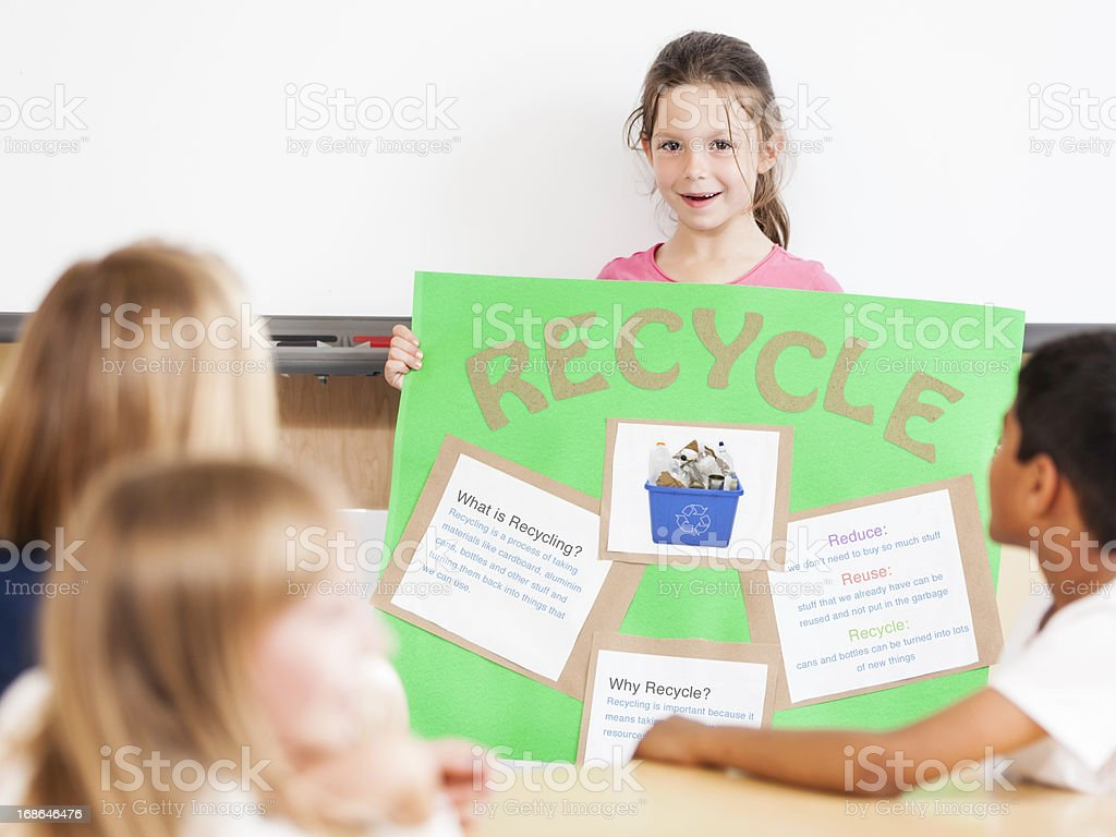 Young Girl Giving a Class Presentation on Recycling royalty-free stock photo