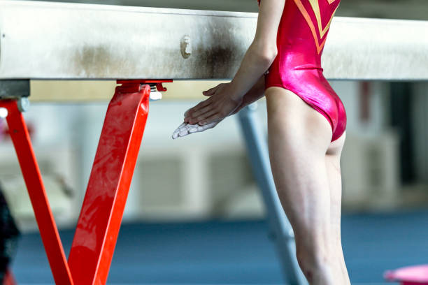 young girl gymnast preparing for her performance on balance beam stock photo