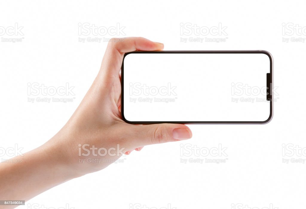 Young girl hands holding black smart phone isolated on white stock photo