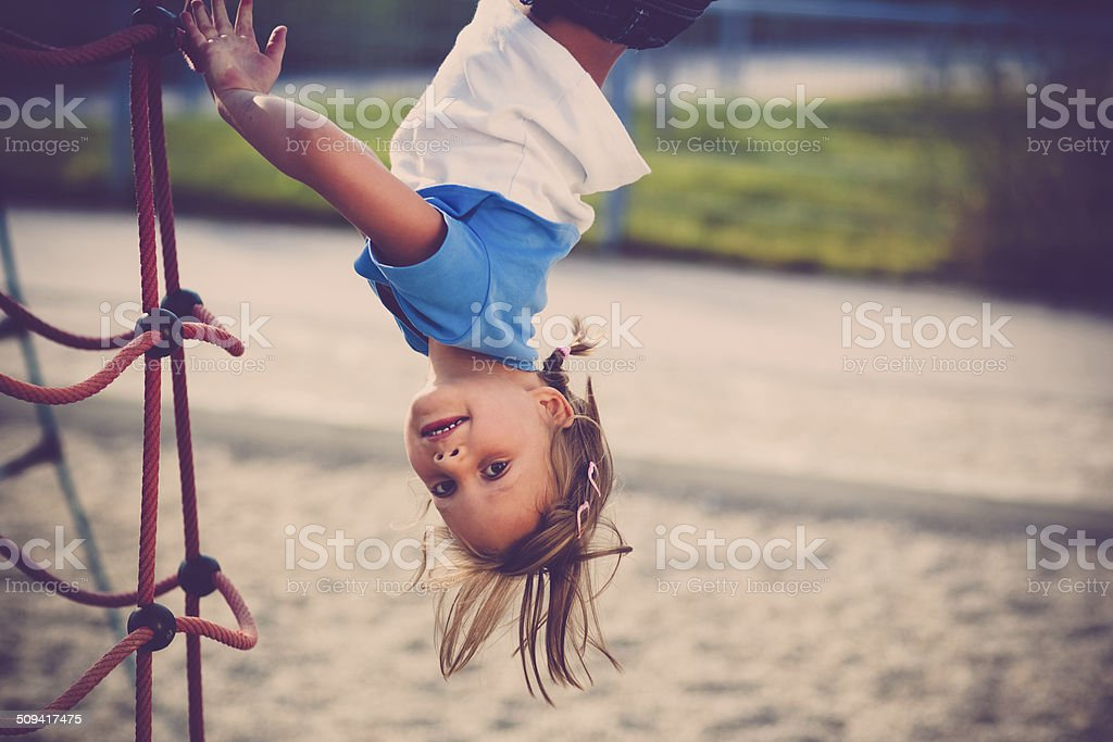 young girl hanging head over stock photo