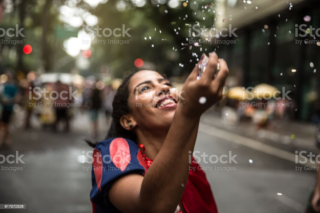 Young girl having fun at the carnival street stock photo