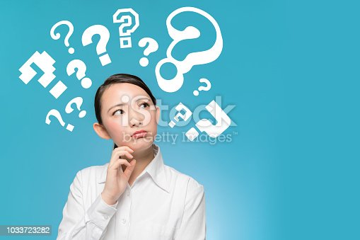 istock Young girl having questions. 1033723282