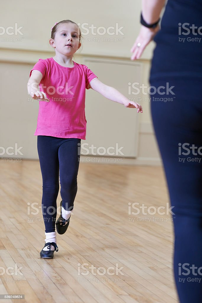 Young Girl Having Tap Dancing Lesson With Teacher stock photo