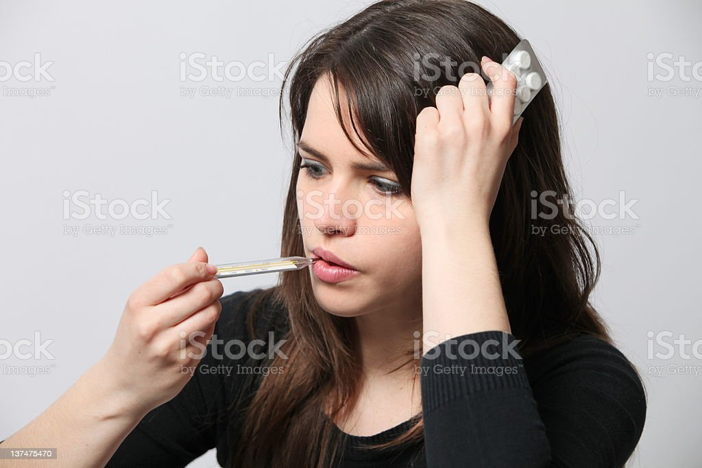 Young girl having temperature infected with flu royalty-free stock photo