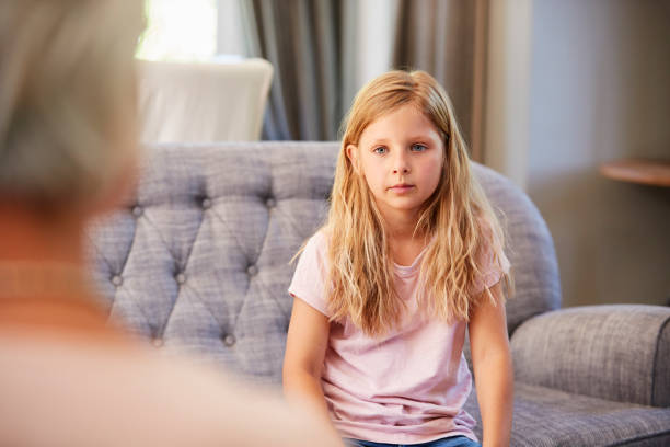 Young girl having therapy with a child psychologist stock photo